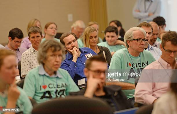 People attend the EPA public hearings, on proposed carbon pollution plan and proposed carbon pollution standards for modified reconstructed power...