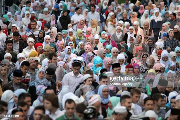 People attend the fifth Republican Iftar Dinner organized within the Muslims' fasting month of Ramadan at the Tennis Academy in Kazan Republic of...