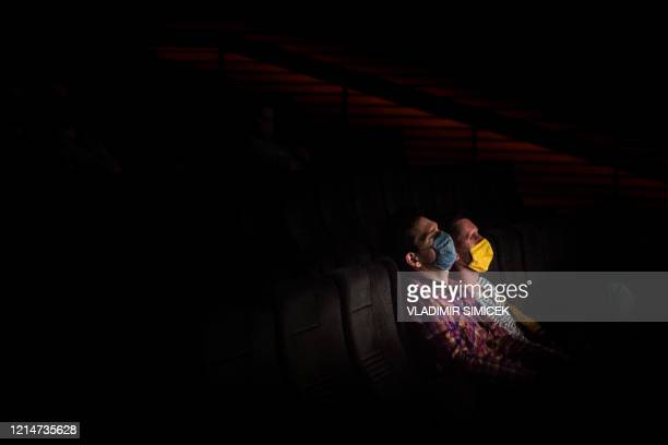 People attend the first movie screening at Lumiere cinema in Bratislava on May 22 2020 after more than a two months lockdown caused by the novel...