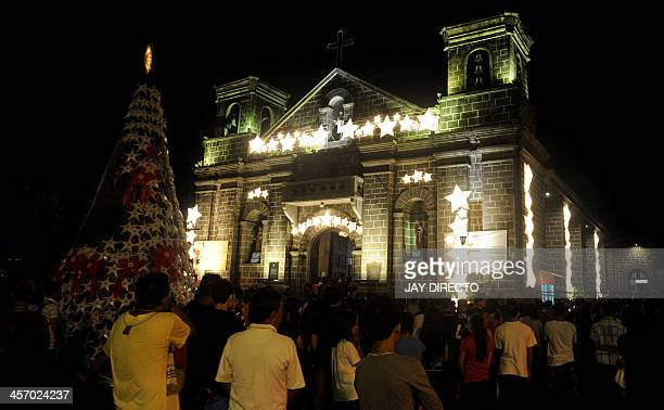 People attend the first of nine dawn masses in suburban Manila on December 16 2013 to signal the official start of the Christmas season The tradition...