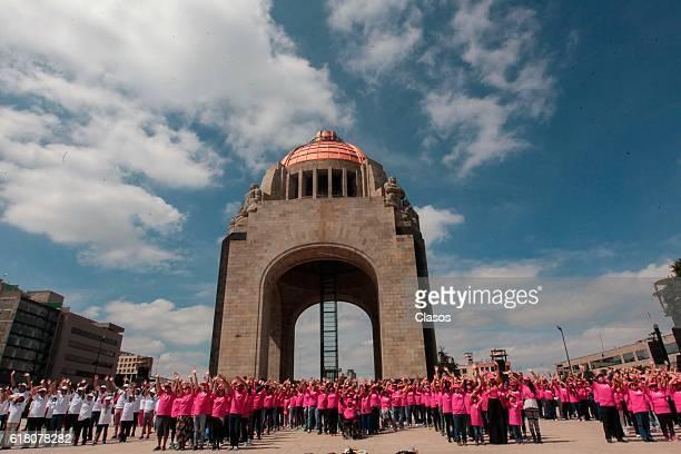 People attend the flashmob 'CDMX Mexico's Pride' at Palacio de Bellas Artes on October 23 2016 in Mexico City Mexico