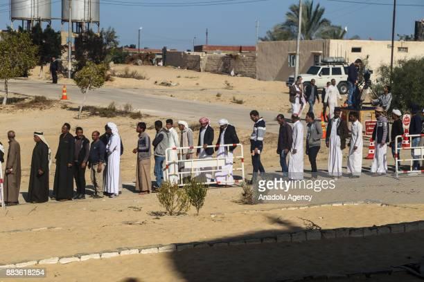 People attend the Friday prayers at alRawda mosque at Bir alAbd town near Arish 400km northeast of Cairo Egypt 01 December 2017