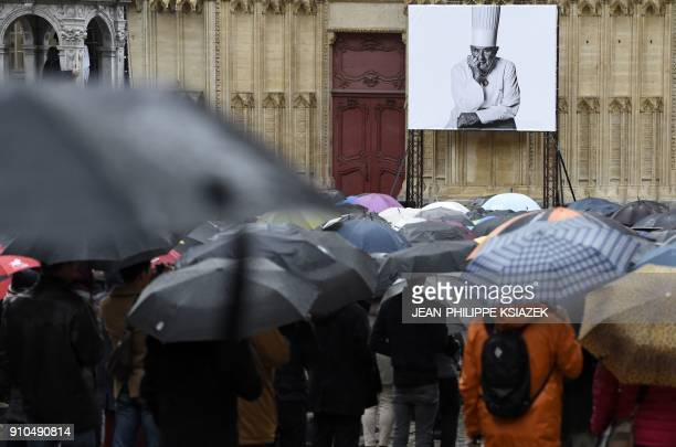 People attend the funeral ceremony for French chef Paul Bocuse at the SaintJean Cathedral in Lyon on January 26 2018 More than 1500 chefs from around...