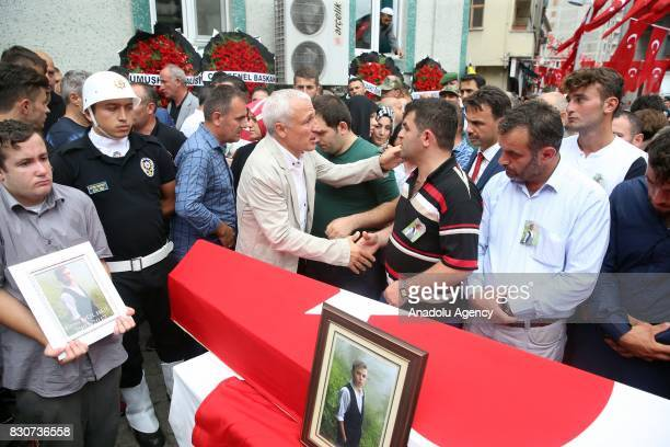 People attend the funeral ceremony of 15yearold boy Eren Bulbul martyred by PKK terrorists in Macka Province of Trabzon Turkey on August 12 2017 Eren...