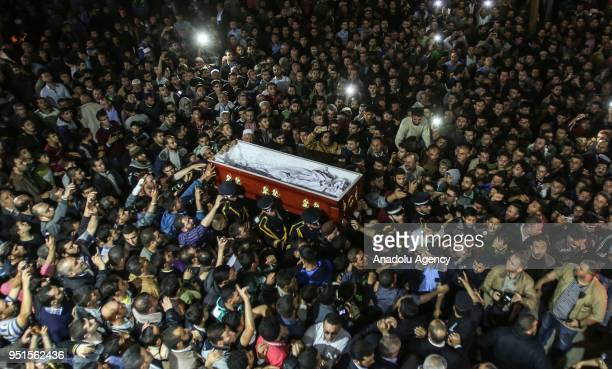 People attend the funeral ceremony of Fadi al-Batsh, a Palestinian Hamas-linked research engineer who was killed by unknown assailants in Kuala...