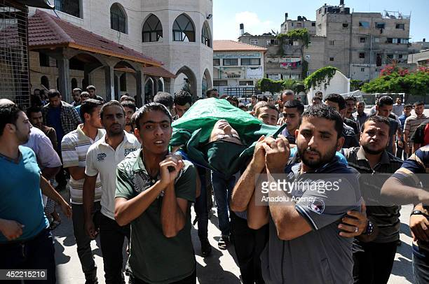 People attend the funeral ceremony of Ismail Fattuh, a 25-year-old Palestinian man who was killed in an Israeli air strike in Gaza City, Gaza on July...