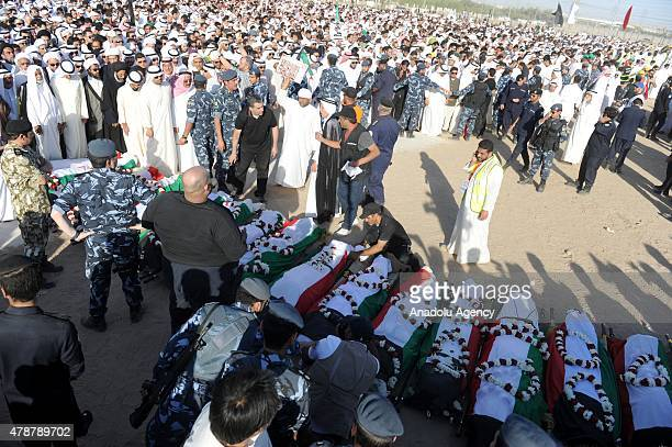 People attend the funeral ceremony of Kuwait suicide attack victims in Kuwait City Kuwait on June 27 2015 At least ten people were killed and 50...