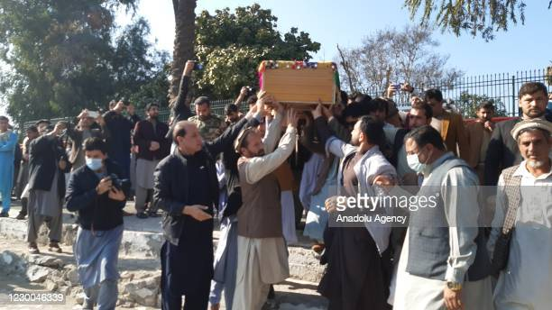 People attend the funeral ceremony of Malalai Maiwand, a journalist at Enikass Radio and TV in Nangarhar, after she was killed along with her driver...
