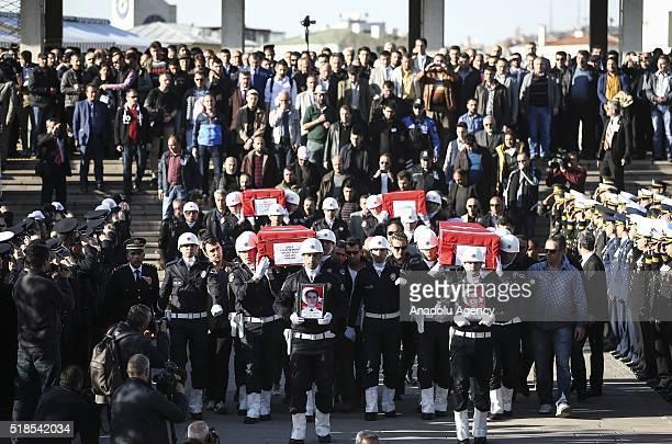 People attend the funeral ceremony of martyred policemen Necdet Alici Mustafa Yigitalp Mehmet Fatih Ertugrul and Alper Zor at Kocatepe Mosque in...