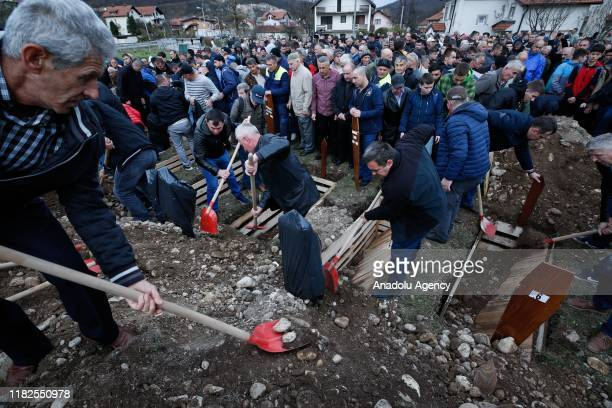 People attend the funeral ceremony of newly found 12 Bosnian war victims in Hadzici of Sarajevo, Bosnia and Herzegovina on November 15, 2019.