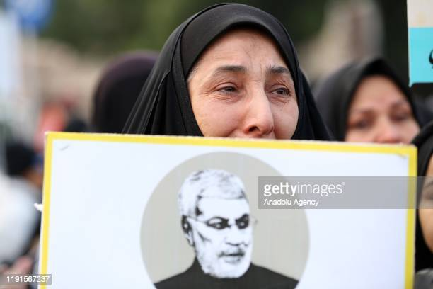 People attend the funeral ceremony of Qasem Soleimani, commander of the Iranian Revolutionary Guards' Quds Forces, and Abu Mahdi al-Muhandis, vice...