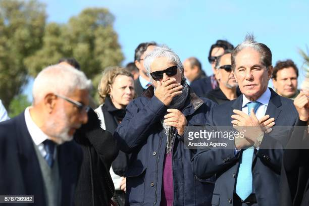 People attend the funeral ceremony of Tunisian fashion designer Azzedine Alaia who died in aged 77 in Paris at the Sidi Bou Said Cemetery in Tunis...