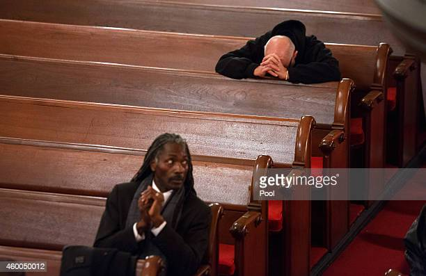 People attend the funeral for Akai Gurley at the Brown Memorial Baptist Church on December 5 2014 in the Brooklyn borough of New York City Gurley was...