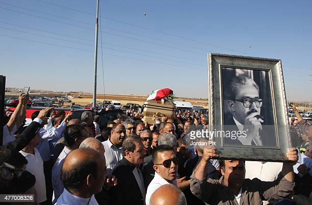 People attend the funeral for Tariq Aziz former Iraqi deputy prime minister and top aide of Saddam Hussein at Al Khuloud cemetery on June 13 2015...