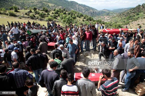 People attend the funeral of a miner who died in a fire at a coal mine at a cemetary on May 15, 2014 in Soma, a district in Turkey's western province...