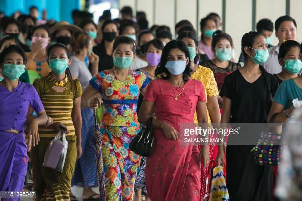 People attend the funeral of a person who died of the H1N1 influenza virus at Yay Way cemetery in Yangon on June 22 2019 Three people have died from...