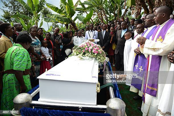 People attend the funeral of Angela Nyokabi who was killed during the attack on Garissa University in her home village of Kiambu on April 10 2015 The...
