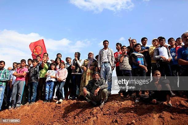 People attend the funeral of Cundi Minaz one of four female Kurdish fighters of the People's Protection Unit who were killed during clashes with...