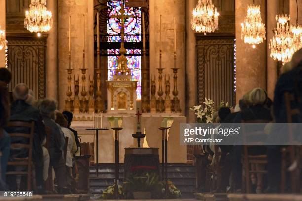 TOPSHOT People attend the funeral of French judge JeanMichel Lambert at the SaintJulien Cathedral in Le Mans northwestern France on July 20 2017...