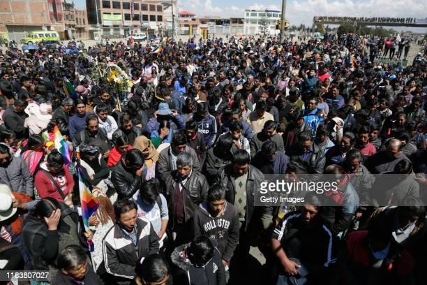 People attend the funeral of three men killed during clashes with police at the Senkata fuel plant on November 21 2019 in El Alto the outskirts of La...