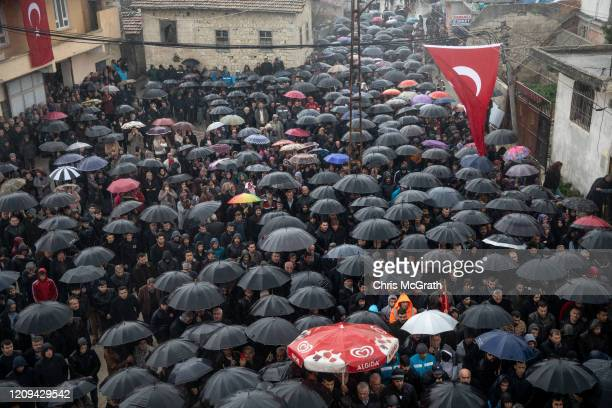 People attend the funeral of Turkish soldier Emin Yildirim who was killed in an airstrike in Idlib on February 27 mourn over his coffin during his...