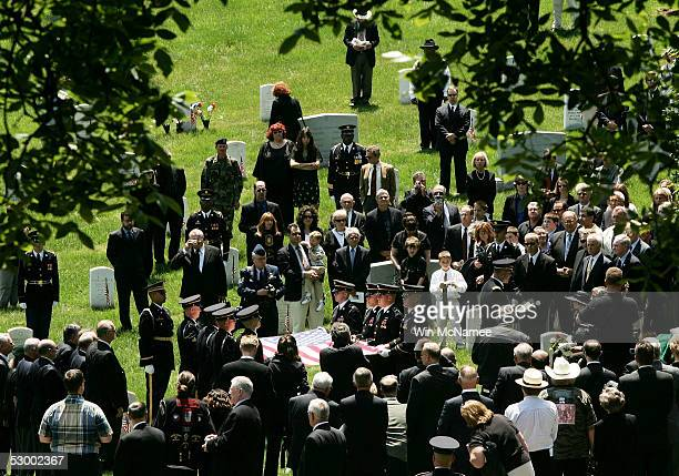 People attend the funeral service for Col David Hackworth during burial services at Arlington National Cemetery May 31 2005 in Arlington Virginia...