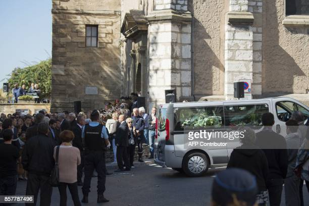 People attend the funerals of Mauranne and Laura two 20yearold cousins stabbed on October 1 2017 outside SaintCharles train station in the coastal...