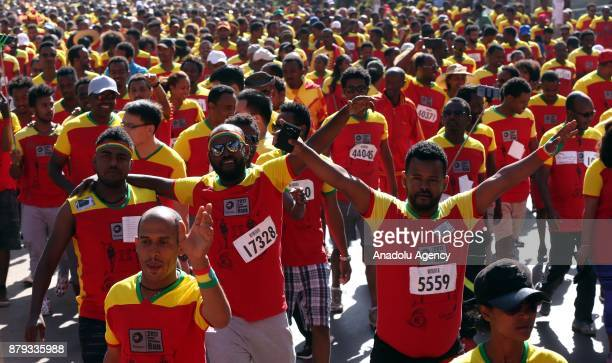 People attend the Great Ethiopian Run at Adwa Square in Addis Ababa Ethiopia on November 26 2017 Total of 44000 professional and amateur athletes...