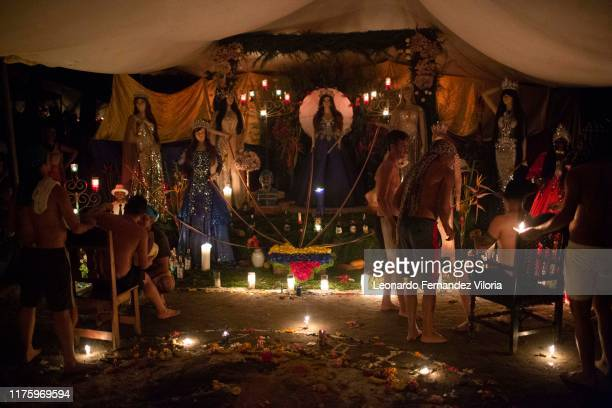 People attend the health ritual of the socalled Chamarreros in search of advice in front of the altar of Queen Maria Lionza in a portal at mountain...