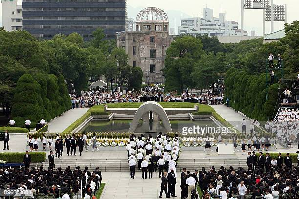 People attend the Hiroshima Peace Memorial Ceremony at the Peace Memorial Park on August 6 2009 in Hiroshima Japan The dropping of the bomb by the US...