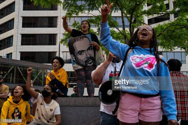People attend the inaugural remembrance rally and march hosted by the George Floyd Global Memorial, commemorating the first anniversary of his death,...