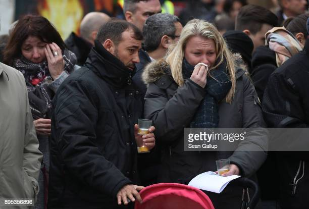 People attend the inauguration of a memorial to victims of the 2016 Christmas market terror attack at Breitscheidplatz on the attack's first...