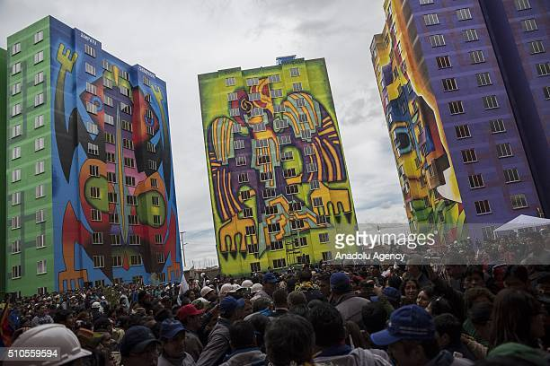 People attend the inauguration of the new buildings of the residential area 'Wiphala', a government's social housing project where renowned Aymara...