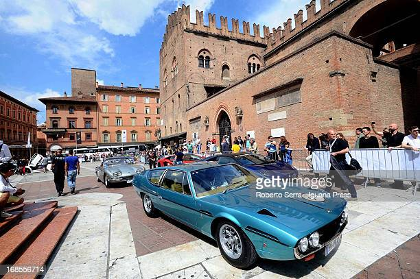 People attend the international automotive meeting for the 50th Anniversary of the Lamborghini at Piazza Maggiore on May 11 2013 in Bologna Italy...