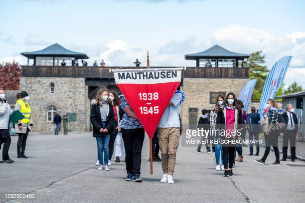 People attend the International Commemoration and Liberation Ceremony at the Memorial of the former concentration camp in Mauthausen, Austria on May...