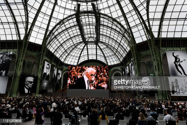 """People attend the """"Karl For Ever"""" event to honour late German fashion designer Karl Lagerfeld at the Grand Palais in Paris, on June 20, 2019. - The..."""