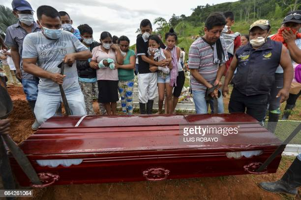 People attend the mass funeral of victims of a mudslide caused by heavy rains at the cemetery in Mocoa Putumayo department Colombia on April 3 2017...