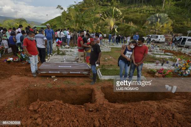 People attend the mass funeral of vistims of a mudslide caused by heavy rains at the cemetery in Mocoa Putumayo department Colombia on April 3 2017...