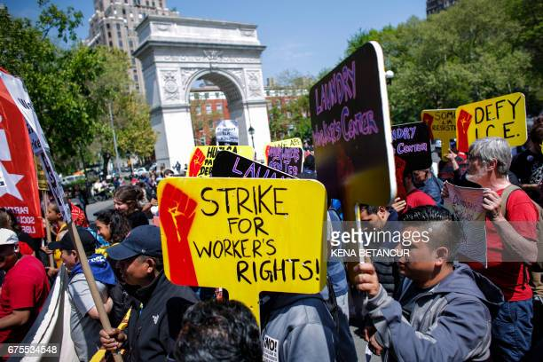 People attend the May day rally in Union Square on May 1 2017 in New York / AFP PHOTO / KENA BETANCUR