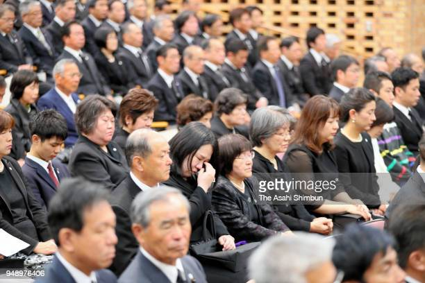 People attend the memorial ceremony on the second anniversary of the Kumamoto Earthquakes on April 14 2018 in Kumamoto Japan The first of the two big...