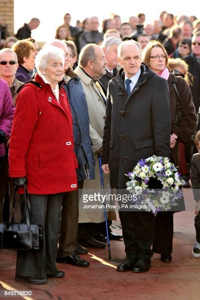 People attend the memorial service in Gynn Square Blackpool to mark the 30th anniversary of three Blackpool police officers losing their lives during...