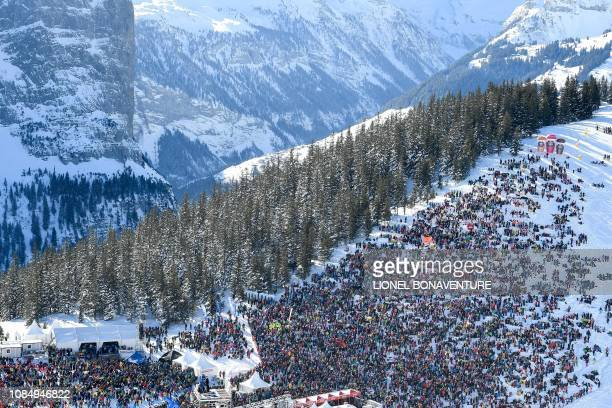People attend the Men's Downhill race of the Lauberhorn during the FIS Alpine Ski World Cup, on January 19 in Wengen.