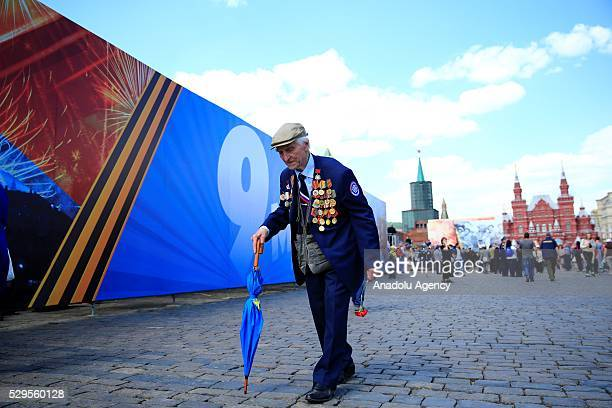 People attend the military parade to mark the 71th anniversary of Victory in the 19411945 Great Patriotic War II Victory in Moscow Russia on May 9...