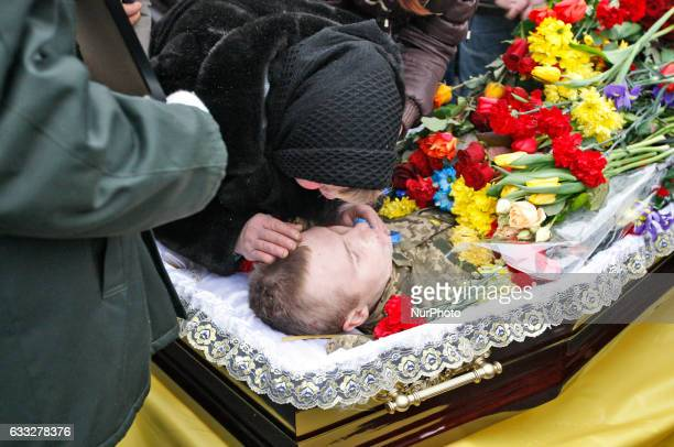 People attend the mourning ceremony of Ukrainian servicemenwho died during fighting in the eastern Ukrainian town of Avdiivkaon Independence Square...