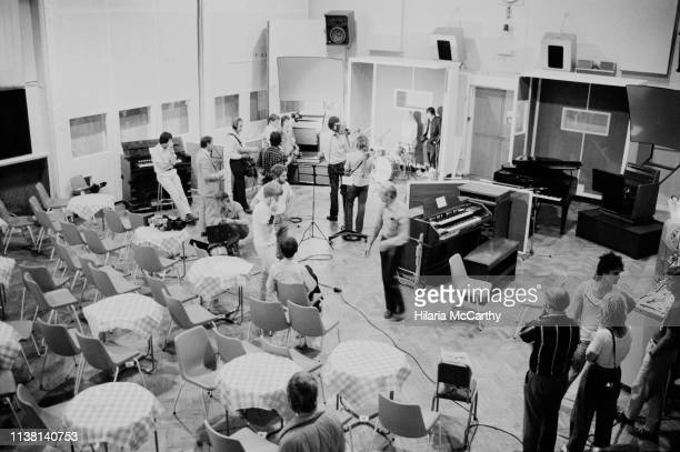 People attend the multimedia presentation of 'The Beatles at Abbey Road' hosted by Abbey Road Studios focusing on the Beatles's recording career,...