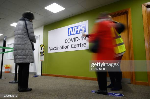 People attend the NHS Covid-19 Vaccination Centre in Robertson House in Stevenage, north of London on January 14, 2021