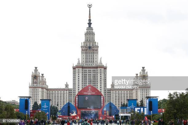People attend the official opening ceremony of the FIFA Fan Fest in Moscow near the main building of the Lomonosov Moscow State University in Moscow...