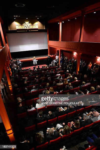 People attend the official reopening of the world's oldest cinema theater L'Eden on October 9 2013 in La Ciotat southern France AFP PHOTO /...
