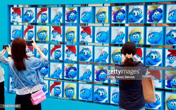 People attend the opening ceremony of the Smurfs Theme Park on May 29 2020 in Shanghai China