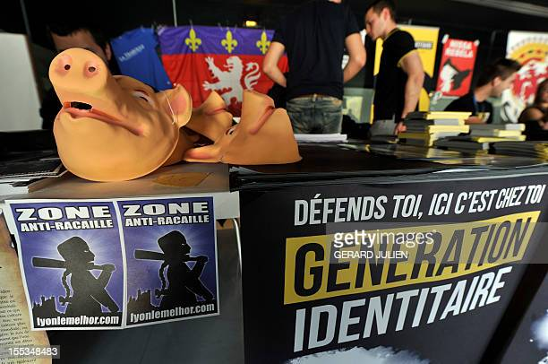 People attend the opening of a two-day convention of the French far-right organization Bloc Identitaire , on November 3, 2012 at the Palais des...